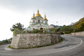 Golden Dome white church on the sky background