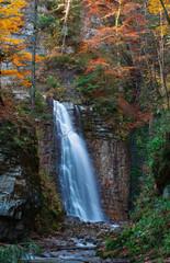 Maniava waterfall in autumn. Carpathians