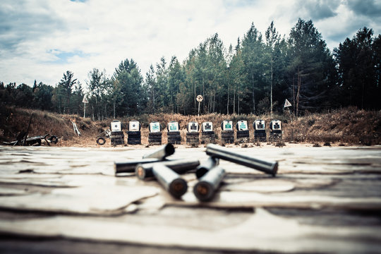 homemade shooting range in the open air with cartridge cases in the foreground