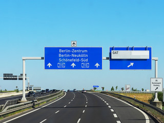 Germany, autobahn, traffic. Road to the center of Berlin, road signs