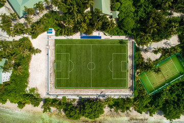 Aerial top view play-field. Empty soccer stadium green field from drone. Football field from above.