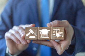 Online law on wooden blocks in attorney hands. Lawyer legal advice consulting business concept.