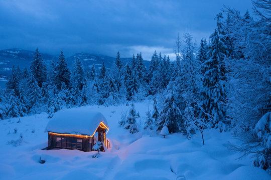 Rustic small cabin in winter scene