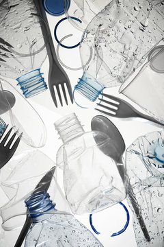 Used water bottles and plastic cutlery