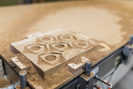 Sawdust Wooden pieces from carving machine in wooden workshop