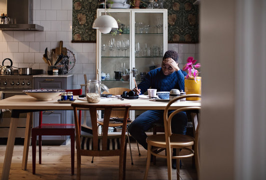 Boy studying at dining table indoors