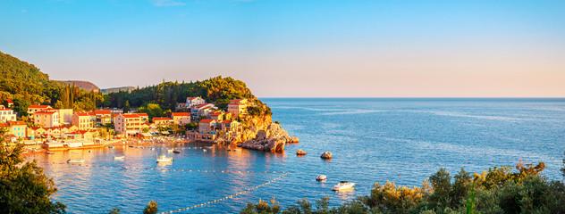 Photo sur Aluminium Europe Méditérranéenne Picturesque summer view of Adriatic sea coast in Budva Riviera. Przno village with buildings on the rock at sunset warm sunlight, Montenegro