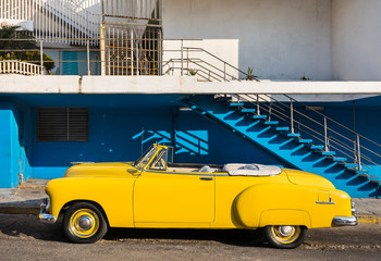 Yellow vintage car parked on road