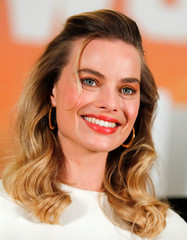 """Cast member Margot Robbie poses for a picture as she takes part in a photo call for the movie """"Once Upon a Time in Hollywood"""" in Beverly Hills, California"""
