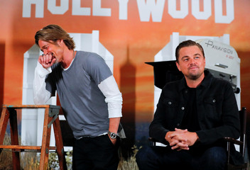 """Cast members Brad Pitt and Leonardo di Caprio pose for a picture as they take part in a photo call for the movie """" Once Upon a Time in Hollywood""""  in Beverly Hills, California"""