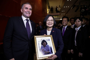 Paraguay ambassador Julio Cesar Arriola Ramirez and Taiwan President Tsai Ing-wen take a picture at Taipei Economic and Cultural Office in New York during her visit to the U.S., in New York City