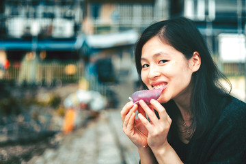 Woman eating traditional chinese sweet sticky rice cake