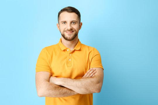 Handsome man on color background