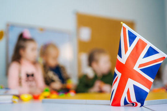 Learn English! School Children. Education in the United Kingdom. Flag of Great Britain.