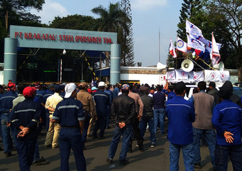 Labourers of PT Krakatau Steel Tbk. gather as they protest outside their office in Cilegon, Banten province