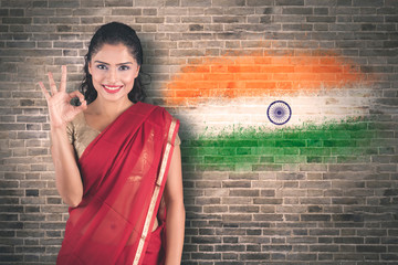 Woman showing OK sign near India flag background