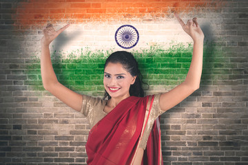 Young woman dancing with India flag background