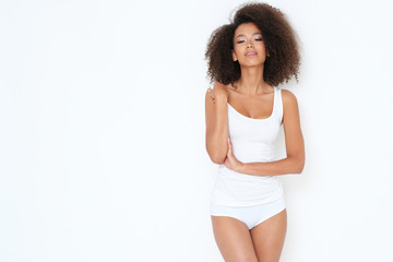 Natural afro -amercian beauty in basic white clothes.