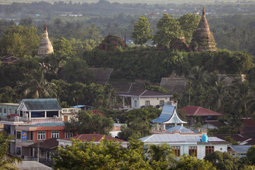 Landscape view of downtown with ancient pagodas in the background in Mrauk U
