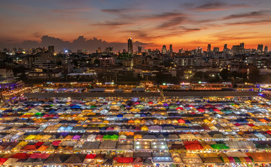 top view of busy Asian street food at railway night market in Thailand with colorful stall and light at night time Wall mural