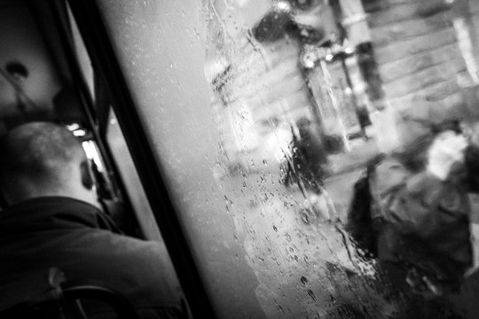 man in the bus and rain outside