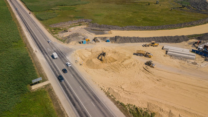 Aerial view of Construction Of Highways . Road Construction Machinery.