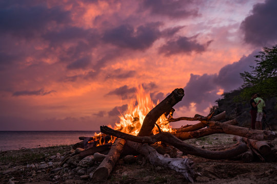 A fantastic sunset at the beach with a bonfire and BBQ on the island of Curacaio