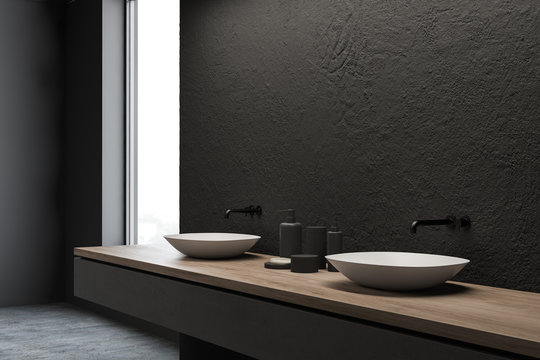 Side view of double sink in grey bathroom