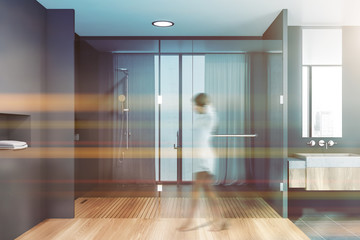 Woman walking in bathroom with shower