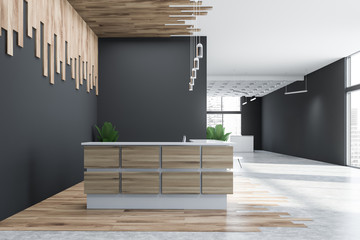 Side view of gray and wooden office reception