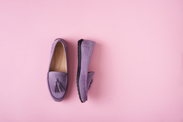 Wall Murals Lilac Lilac suede moccasins shoes over lilac pink background