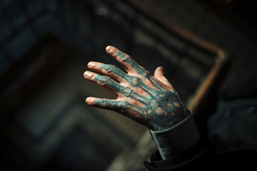 man's hand with tattoo