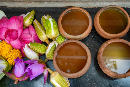 Flowers and Scented Waters as Offerings at a Buddhist Temple, Anuradhapura, Sri Lanka