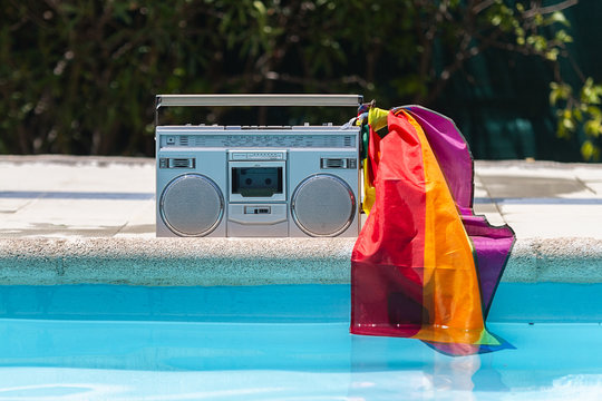 old radio in the pool with the lgbt pride flag