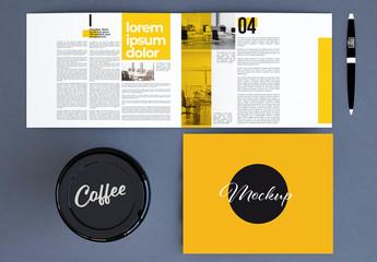 Desktop with Brochure, Pen, and Cup Mockup
