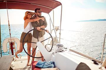 luxury couple on the boat enjoy on summer holiday.