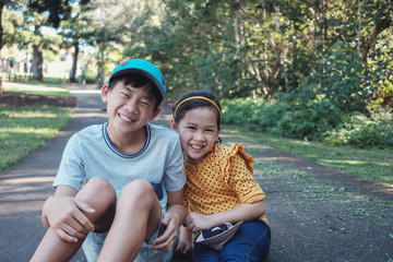 Mixed Asian little brother and sister outdoors , Happy children portrait