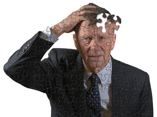 Front view and face of senior caucasian man afraid of dementia and Alzheimer's disease using jigsaw concept