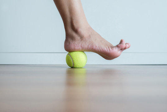Woman massage with tennis ball to foot,Feet soles or heel massage for plantar fasciitis
