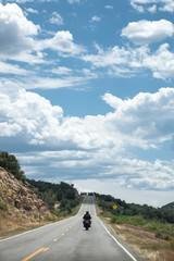 Biker portrait riding on scenic road trip - Highway 145, Colorado