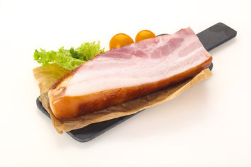 Smoked pork breast with salad leaves