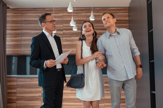 Wife feeling amazing while buying new apartment with husband