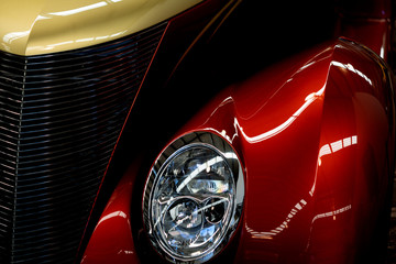 Close Up Of Red And Yellow Classic Car Headlight