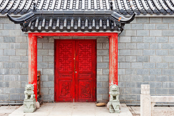 red chinese door to temple