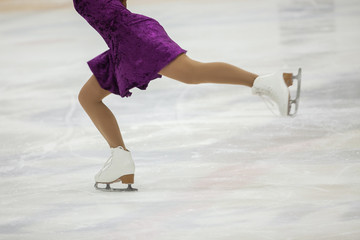 Figure skating, ice skating training. Feet skater on the ice
