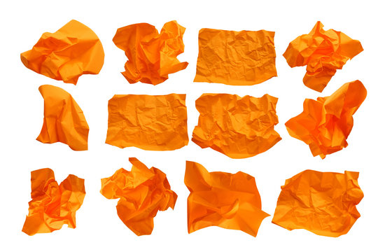 Close-up group of crumpled oranges paper isolated on a white background