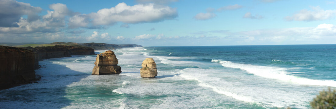 panoramic views of wild winter waves crashing against iconic Australian sandstone rock formations, the twelve apostles, great ocean road, Southern Victorian Coast