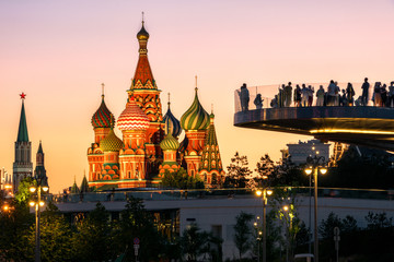 Wall Mural - Moscow city center at night, Russia. People in Zaryadye Park overlooking St Basil`s Cathedral and Moscow Kremlin. This place is tourist attraction of Moscow. Concept of travel and vacation in Moscow.