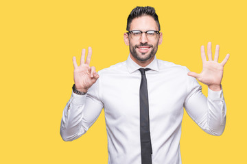 Young handsome business man wearing glasses over isolated background showing and pointing up with...