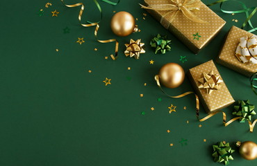 christmas or new year frame decorations in gold colors on dark green color background with empty...